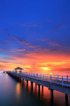 Wooded bridge in the beach island port between sunrise. photo