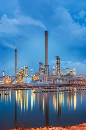Oil refinery at twilight sky and reflexsion photo