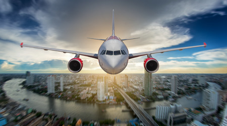 airplane landing: Passenger airplane landing on runway in airport. ovey bangkok sky Stock Photo