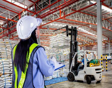 Forklift loader with big bag of sugar in distribution warehouse photo