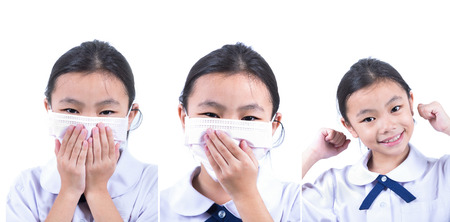 facemask: Common cold little asia girl with facemask in white isolated background Stock Photo