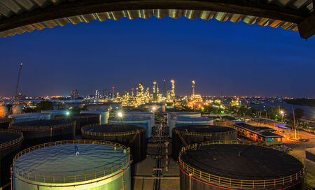 refinement: Landscape of oil refinery industry with oil storage tank and pulution environment Stock Photo
