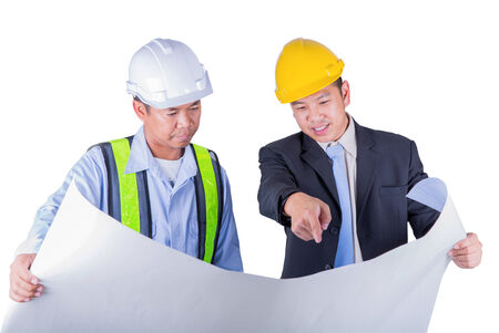 Asian engineer and worker leader discus for drawing detail in isolated white background and clipping part. photo