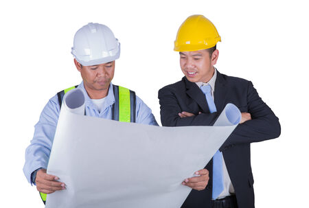 out of production: Asian engineer and worker leader discus for drawing detail in isolated white background and clipping part. Stock Photo