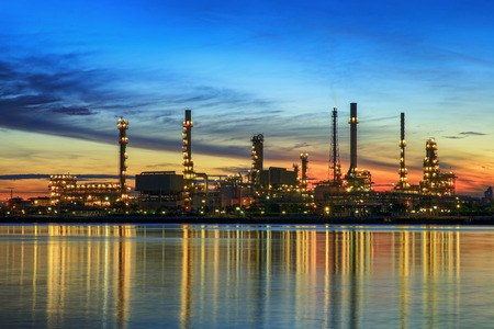 petrochemical plant in night time with reflection over the river Foto de archivo