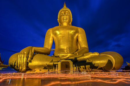 angthong: Candlelight Makha Bucha Day at Wat Muang with gilden giant big Buddha statue in Angthong, Thailand