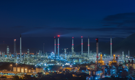 manufacturing equipment: oil refinery industry plant and port along the morning twilight