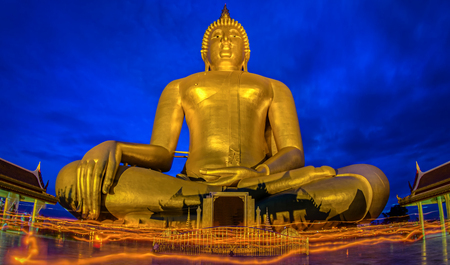 Candlelight Makha Bucha Day at Wat Muang with gilden giant big Buddha statue in Angthong, Thailand