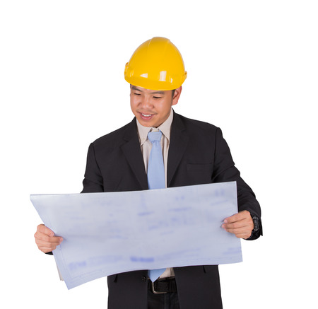 asian architect: Happy young asian engineer architect read a drawing on white background and clipping path Stock Photo