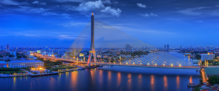 river scape: City scape of Rama VIII Bridge at night in Bangkok and Chopraya river, Thailand