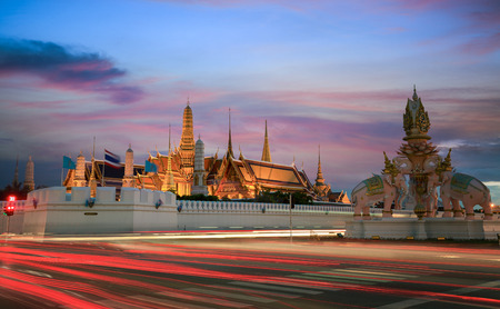 grand palace: Grand palace at twilight with light from traffic in Bangkok, Thailand Stock Photo