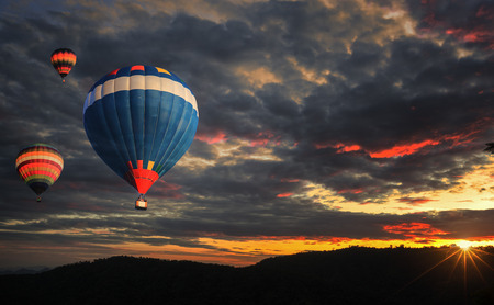 airborne: Colorful hot air balloon is flying at sunrise