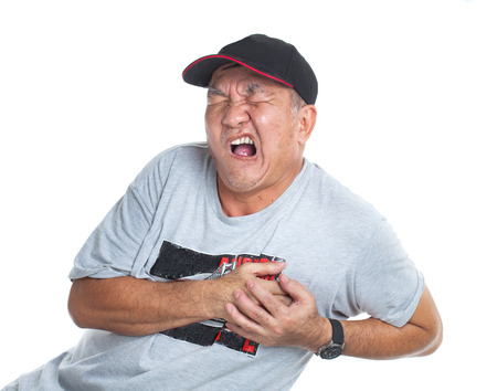 A old man suffering pain from a heart attack photo