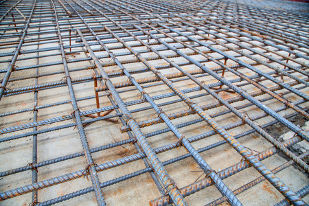 concreting: Rebar grids in a concrete floor during a pour