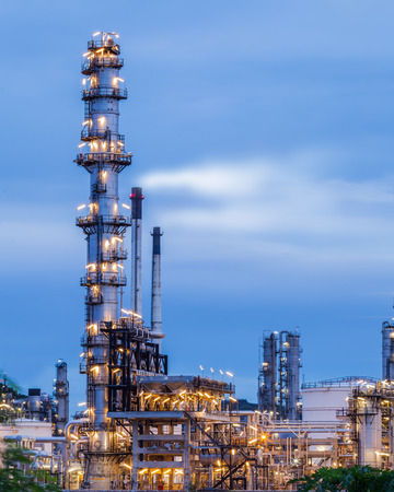 petrochemical plant in night time with reflection over the river photo