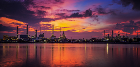 petrochemical plant in night time with reflection over the river Stock Photo