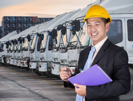 Transportation engineer with trucks of a transporting company in a row Standard-Bild