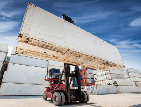 lifter: Big white container box handling in logistic port Stock Photo
