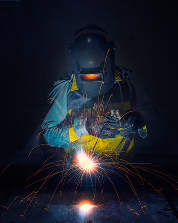 worker work hard with welding process in production plant photo