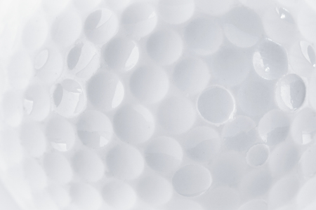 CLose up of a Golf Ball texture by macro lence and special tube Stock Photo