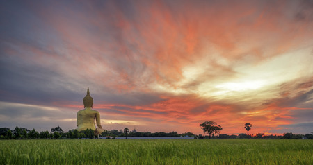 sukhothai: Wat Muang with gilden giant big Buddha statue in Thailand