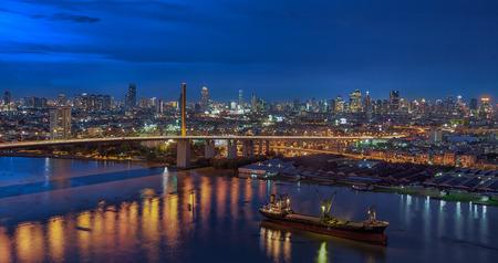 ix: The Bridge across the river with Modern Building at dusk (Bangkok, Thailand)