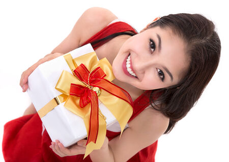 Beautiful Asia woman wear Santa Clause costume, christmas girl happy smile hold new year gift box present, in isolated on white background photo