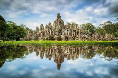heritage site: Angkor Wat with reflextion, Ta Prohm Khmer ancient Buddhist temple in jungle forest. Famous landmark, place of worship and popular tourist travel destination in Asia Stock Photo