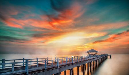 Wooded bridge in the port along sunrise photo