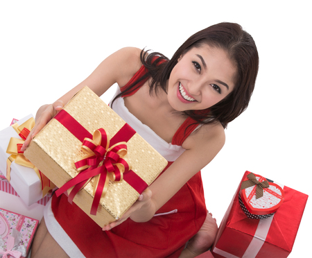 Beautiful Asia woman wear Santa Clause costume, christmas girl happy smile hold new year gift box present (clipping part for easy to use) photo