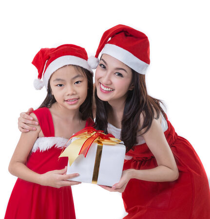 Beautiful Asia woman and girl wear Santa Clause costume, christmas girl happy smile hold new year gift box present, in isolated on white background photo