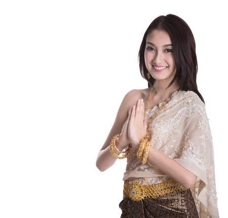 thai ethnicity: Thai Lady in vintage original Thailand attire Sawasdee action welcome in thai style (clipping part for easy to use)