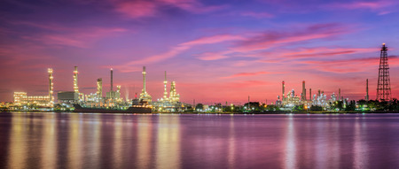 petrochemical: petrochemical plant in night time with reflection over the river Stock Photo