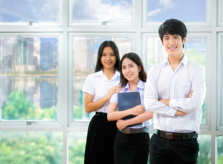 Asia students read in Library with uniform