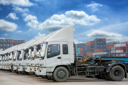 Raw of Truck in container depot with blue sky and logistic background Stock Photo