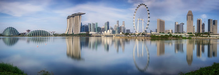 settlements: Landscape of the Singapore financial district with flyer and reflection