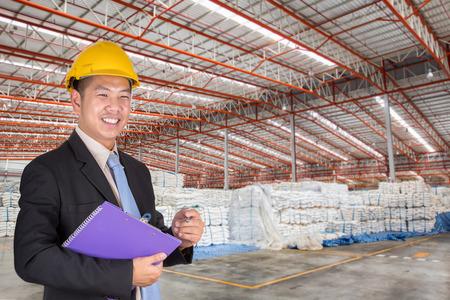 Engineer working in the warehouse surgar bag photo