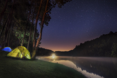 tent: Small Camping Tent Illuminated Inside. Night Hours Campsite. Recreation and Outdoor Photo Collection. Stock Photo