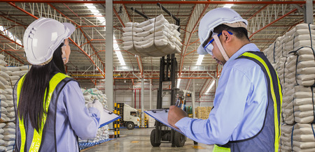 loading truck: The worker report and check stock in sugar distribution warehouse