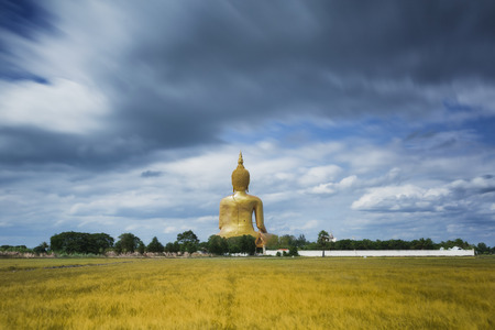 ange: Wat Muang with gilden giant big Buddha statue in Thailand