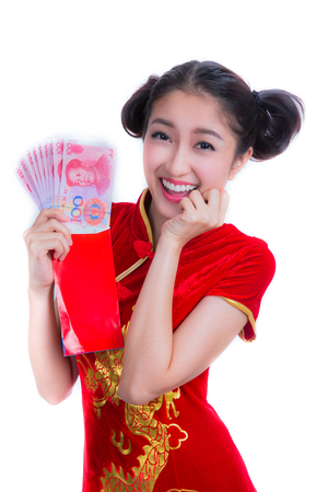 chipao: happy chinese new year. smile asian woman holding red envelope isolated on red background Stock Photo