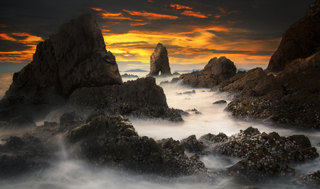 tides: Sunset with the tid rock near Patayabeach, thailand Stock Photo