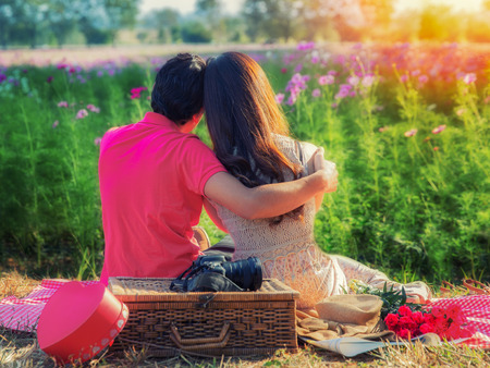 romance couple: Young couple in love, Attractive man and woman enjoying romantic date at the garden sunset Stock Photo