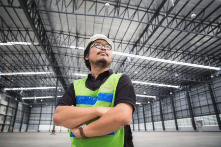 space   area: Engineer working and standing in new warehouse and space area