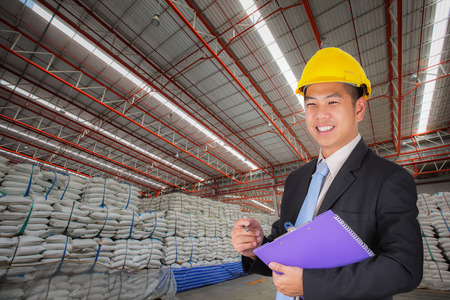 agriculture industry: Engineer working in the warehouse surgar bag