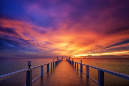 Wood bridge along sunset in island beach