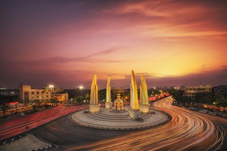 democracy Monument: Moment of Democracy monument at Dusk (Bangkok, Thailand) sunset and traffic Stock Photo