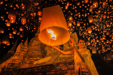 newyears: Thai people floating lamp in Ayuthaya historical park, with Wat Phra Sri Sanphet temple background, Thailand