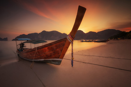 long tailed boat: andaman long tailed boat southern of thailand on the sunset beach in Phi phi island  near phuket