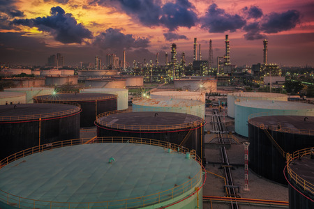 Oil refinery and oil thank in sunset background photo